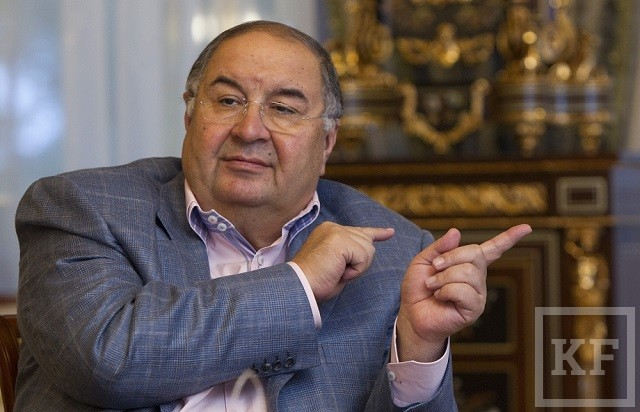 Metalloinvest founder Usmanov gestures during an interview with Reuters journalists at his home outside Moscow