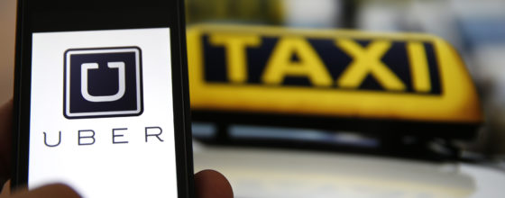 An illustration picture shows the logo of car-sharing service app Uber on a smartphone next to the picture of an official German taxi sign in Frankfurt, September 15, 2014. A Frankfurt high court will hold a hearing on a recent lawsuit brought against Uberpop by Taxi Deutschland on Tuesday.  San Francisco-based Uber, which allows users to summon taxi-like services on their smartphones, offers two main services, Uber, its classic low-cost, limousine pick-up service, and Uberpop, a newer ride-sharing service, which connects private drivers to passengers - an established practice in Germany that nonetheless operates in a legal grey area of rules governing commercial transportation. The company has faced regulatory scrutiny and court injunctions from its early days, even as it has expanded rapidly into roughly 150 cities around the world.   REUTERS/Kai Pfaffenbach (GERMANY - Tags: BUSINESS EMPLOYMENT CRIME LAW TRANSPORT) - RTR468Z2